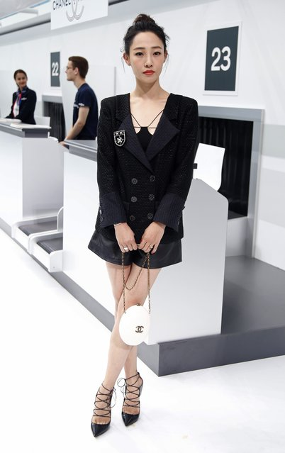 Chinese Actress Bai Baihe poses before the Spring/Summer 2016 women's ready-to-wear collection for fashion house Chanel at the Grand Palais which is transformed into a Chanel airport during the Fashion Week in Paris, France, October 6, 2015. (Photo by Charles Platiau/Reuters)