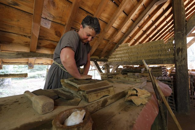A potter works at the construction site of the Chateau de Guedelon near Treigny in the Burgundy region of France, September 13, 2016. (Photo by Jacky Naegelen/Reuters)