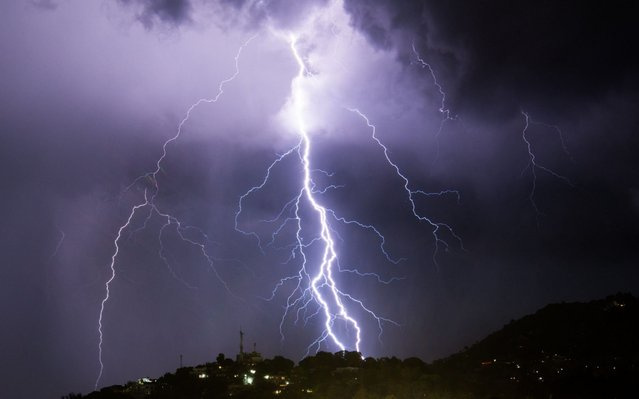 Lightning strikes during an electrical storm over Port-au-Prince on June 25, 2019. (Photo by Chandan Khanna/AFP Photo)