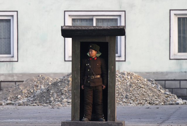 A soldier stands guard at a sentry on the banks of the Yalu River, near the North Korean town of Sinuiju, opposite the Chinese border city of Dandong, November 15, 2014. (Photo by Jacky Chen/Reuters)