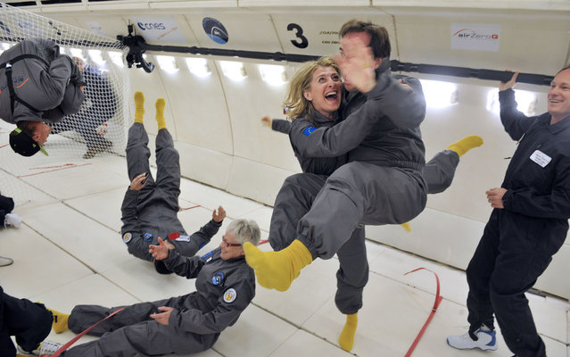 Civilian passengers of the Airbus A330 Zero-G, who are not astronauts nor scientists, enjoy the weightlessness, on March 15, 2013, during the first zero gravity flight for paying passengers in Europe. All boarding cards, costing 6,000 euros, were sold for the years 2013 and 2014. (Photo by Mehdi Fedouach/AFP Photo)