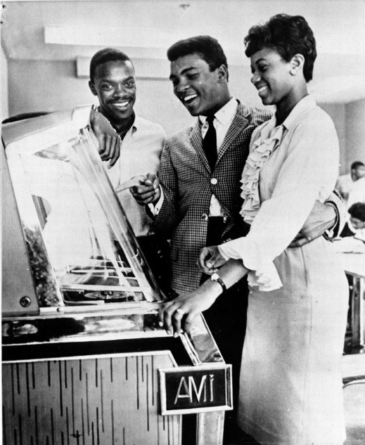 Heavyweight boxer Muhammad Ali (center) the Olympic champ turned pro, visited Tennessee A&I State University at Nashville, Tennessee on Wednesday, October 26, 1961 for a reunion with fellow Olympic Ralph Boston and Wilma Rudolph, both track stars. The Louisville boxer says he?s ready to most champion Floyd Patterson. He will seek his 10th straight pro win on December 13 at Louisville against Willi Besmanoff. (Photo by AP Photo)