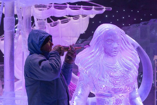Sculptor Jiri Genzer of the Czech Republic carves an ice sculpture at the Disney Dreams Ice Festival in Antwerp November 27, 2014. Some 60 artists from all over the world participated in the festival, making sculptures out of around 500 tonnes of ice. The festival will open on November 29 until January 11, 2015. (Photo by Yves Herman/Reuters)