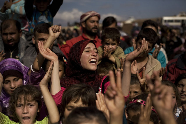 A Syrian displaced girl chants slogans during a demonstration in a refugee camp near Atma, Idlib province, Syria, Friday, October 26, 2012. (Photo by Manu Brabo/AP Photo)
