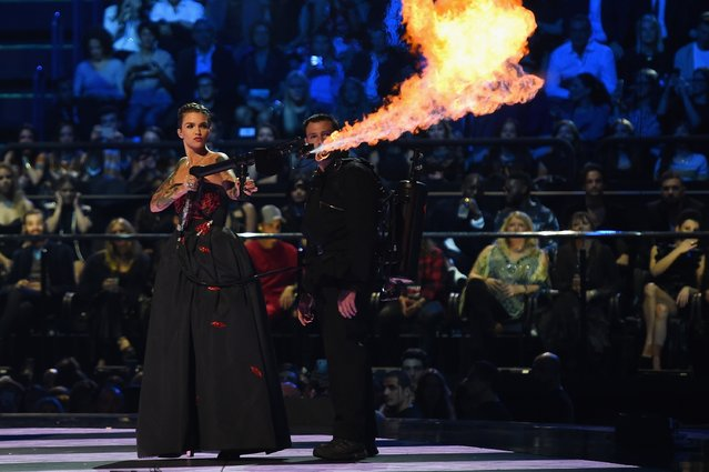 Co-host actress Ruby Rose blows a fire gun on stage during the MTV EMA's 2015 at the Mediolanum Forum on October 25, 2015 in Milan, Italy. (Photo by Brian Rasic/Getty Images for MTV)