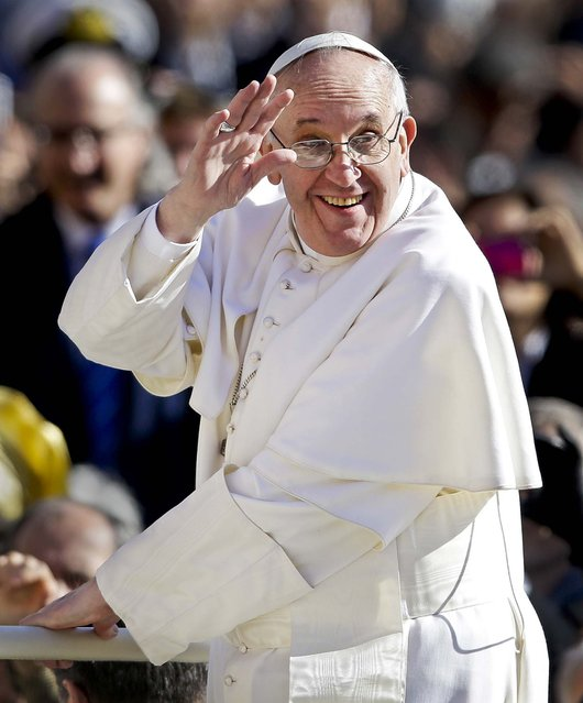 Pope Francis waves to crowds as he arrives for his inauguration Mass in St. Peter's Square at the Vatican, on March 19, 2013. (Photo by Gregorio Borgia/Associated Press)