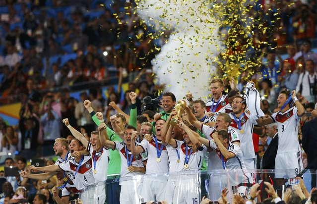 Germany's players lift the World Cup trophy as they celebrate their 2014 World Cup final win against Argentina at the Maracana stadium in Rio de Janeiro, in this July 13, 2014 file photo. (Photo by Darren Staples/Reuters)