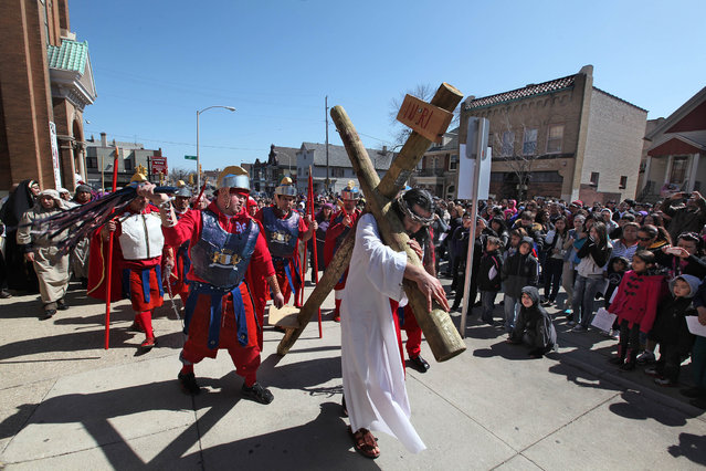 "Jose Hernandez portrays Jesus as Catholic faithful gather at St. Vincent de Paul Parish, the first stop on  the 29th annual ""Crucis Viviente"", on Good Friday, March 29, 2013. Coordinated by the Archdiocese of Milwaukee's Hispanic Ministry Office, performers from the Hispanic community will reenact the Stations of the Cross in Spanish.  The play recounts major events that occurred before Jesus Christ was sentenced to death by Pontius Pilate. Afterwards, actors, along with the Hispanic Catholic community of southeastern Wisconsin, will follow a mile-and-a-half street route as they pray the Stations of the Cross. Stopping at 15 designated areas, each ""station"" is marked by posters outlining how Jesus walked to his death and was resurrected (due to the large crowd expected, all streets during the route are closed to traffic).  The procession begins at 1 p.m. at St. Vincent de Paul Parish, 2114 W. Mitchell St., Milwaukee. Archbishop Listecki will read Scripture at the ninth station at approximately 3 p.m., at St. Hyacinth Parish, 1414 W. Becher St., Milwaukee. The event concludes at the Basilica of St. Josaphat, 601 W. Lincoln Ave., Milwaukee at approximately 5 p.m. (Photo by Rick Wood)"