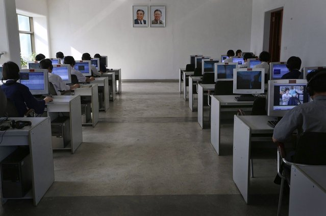 North Korean students study in front of portraits of the country's late leaders Kim Il Sung, left, and his son Kim Jong Il at the Kim Chaek University of Technology in Pyongyang, on September 20, 2012. (Photo by Vincent Yu/AP Photo)