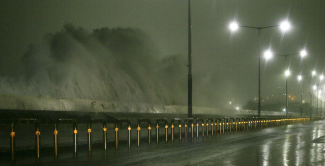 High waves rise over a road as Typhoon Chaba approaches Jeju Island, South Korea, 05 October 2016. (Photo by EPA/Yonhap)