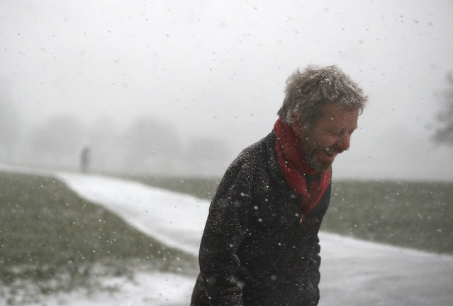 A man walks through a snow flurry on Primrose Hill in London, Britain February 27, 2018. (Photo by Peter Nicholls/Reuters)