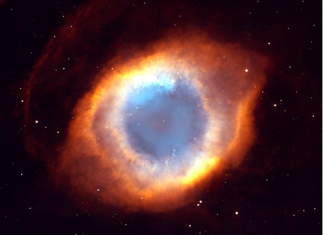 This photograph of the coil-shaped Helix Nebula is one of the largest and most detailed celestial images ever made. The composite picture is a seamless blend of ultra-sharp images from NASA's Hubble Space Telescope combined with the wide view of the Mosaic Camera on the National Science Foundation's 0.9-meter telescope at Kitt Peak National Observatory near Tucson, Ariz. (Photo by NASA/WireImage)