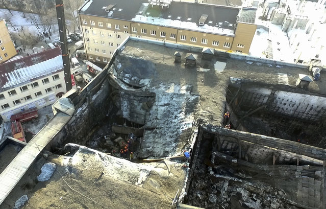 In this Russian Emergency Situations Ministry photo, taken on Monday, March 26, 2018, an aerial view of the multi-story shopping center after a fire, in the Siberian city of Kemerovo, about 3,000 kilometers (1,900 miles) east of Moscow, Russia. Russian officials say a fire at a shopping mall in a Siberian city has killed over 50 people. The Ekho Mosvky radio station quoted witnesses who said the fire alarm did not go off and that the staff in the mall in Kemerovo did not organize the evacuation. (Photo by Russian Ministry for Emergency Situations photo via AP Photo)