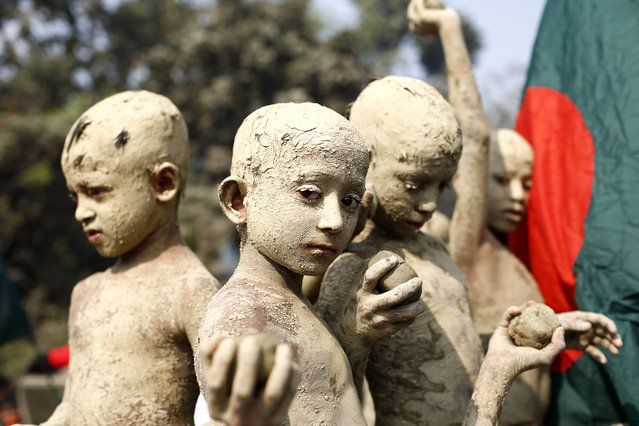 Bangladeshi children, covered in mud to look like freedom fighters, attend a rally during the Victory Day celebration in Gazipur, Bangladesh, December 16, 2014. Bangladesh marks 43rd Victory Day across the country remembering the war heroes. Bangladesh became a free nation after a nine-month bloody war against Pakistan on December 16, 1971. (Photo by Abir Abdullah/EPA)