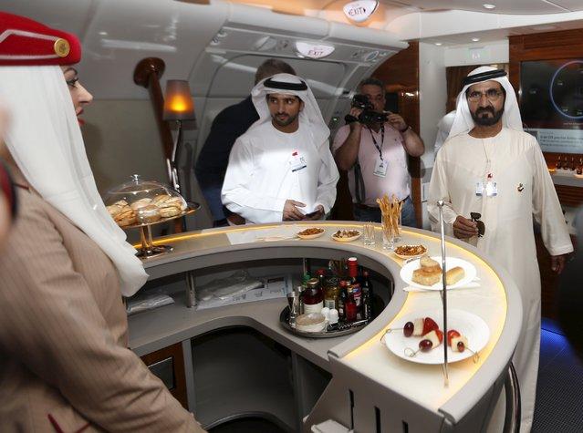 United Arab Emirates Vice President, Prime Minister and Dubai Ruler, Sheikh Mohammed bin Rashid al-Maktoum (R) visits an Airbus A380 plane at the Dubai Airshow November 8, 2015. (Photo by Ahmed Jadallah/Reuters)