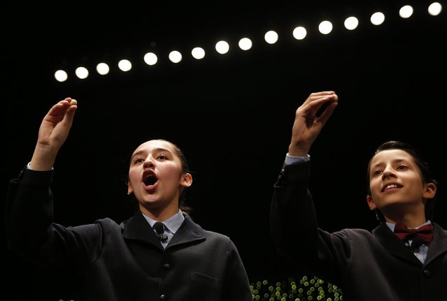 """Schoolchildren call out the winning number, 13437, during the draw for Spain's Christmas Lottery """"El Gordo"""" in Madrid December 22, 2014. (Photo by Juan Medina/Reuters)"""