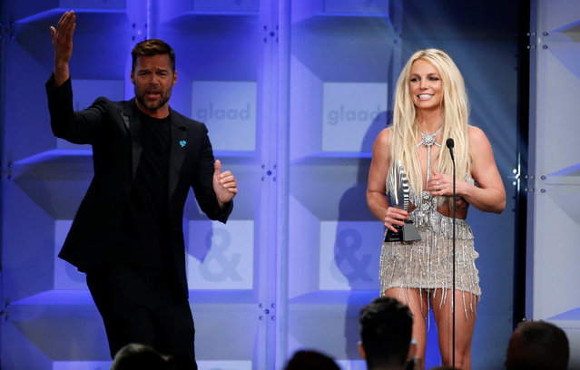 Singer Britney Spears accepts the Vanguard Award next to presenter Ricky Martin at the 29th Annual GLAAD Media Awards in Beverly Hills, California, U.S., April 12, 2018. (Photo by Mario Anzuoni/Reuters)