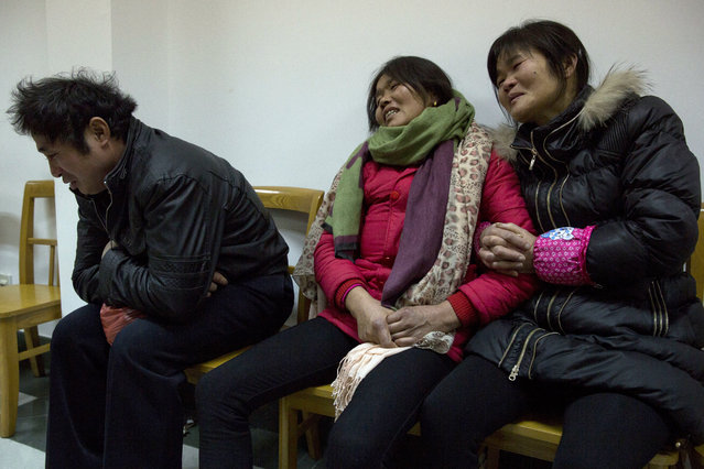 Relatives of Pan Hanqin who was one of the victim of a deadly stampede grief as they wait for answers in a government compound in Shanghai, China, Friday, January 2, 2015. People unable to contact friends and relatives streamed into hospitals Thursday, anxious for information after a stampede during New Year's celebrations in Shanghai's historic waterfront area killed 36 people in the worst disaster to hit one of China's showcase cities in recent years. (Photo by Ng Han Guan/AP Photo)