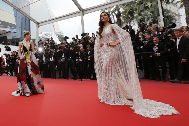 Amber Heard and Deepika Padukone pose as they arrive for the screening of the film Sorry Angel (Plaire, aimer et courir vite) May 10, 2018 during the 71st annual Cannes Film Festival in Cannes, France. (Photo by Jean-Paul Pelissier/Reuters)