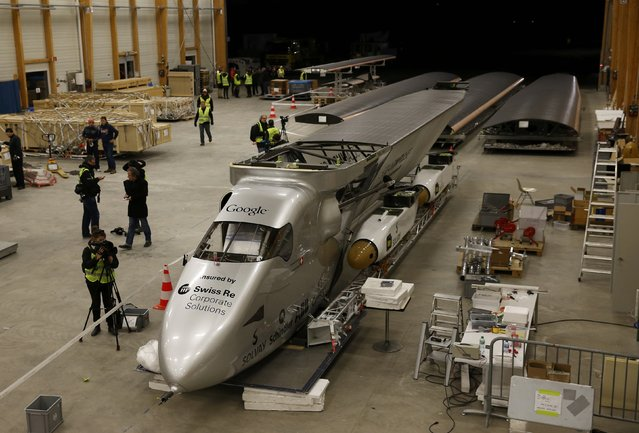 The dismantled Solar Impulse 2 aircraft is pictured before being loaded into a Cargolux Boeing 747 cargo aircraft at Payerne airport, Switzerland January 5, 2015. The Solar Impulse 2 aircraft and its team relocates to Abu Dhabi from where an attempt to fly around the world in stages using only solar energy will be made from March 2015. (Photo by Denis Balibouse/Reuters)