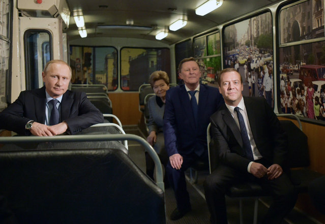 Russian President Vladimir Putin (L), Prime Minister Dmitry Medvedev (R), head of the Presidential administration Sergei Ivanov (2-R) and widow of the first Russian President Boris Yeltsin Naina (2-L) attend unveiling of the memorial Yeltsin-center in Yekaterinburg, Russia, 25 November 2015. (Photo by Alexander Astafyev/EPA/Government Press Service)