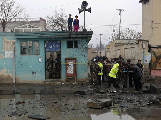 Afghan security personnel investigate the site of a blast in Kabul January 13, 2015. The Taliban claimed responsibility for the car bomb attack that killed two people in the capital, Kabul, on Tuesday. (Photo by Mohammad Ismail/Reuters)