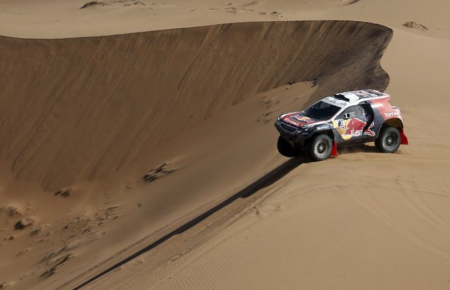 Peugeot driver Stephane Peterhansel of France drives during the 4th stage of the Dakar Rally 2015, from Chilecito to Copiapo January 7, 2015. (Photo by Jean-Paul Pelissier/Reuters)