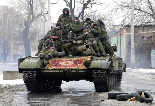 Members of the armed forces of the separatist self-proclaimed Donetsk People's Republic drive a tank on the outskirts of Donetsk January 22, 2015. (Photo by Alexander Ermochenko/Reuters)