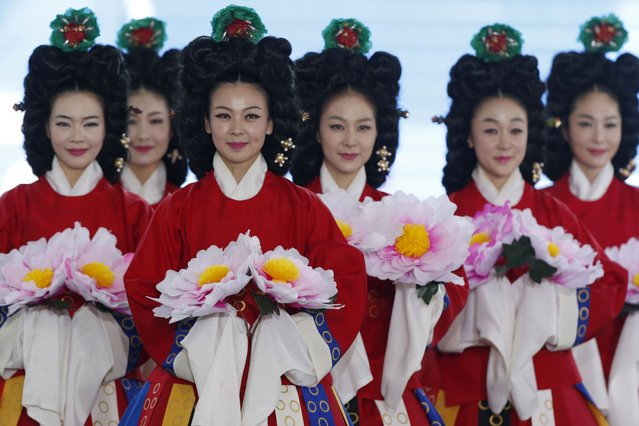 Traditional dancers perform during a commemorative ceremony of the 60th anniversary of Ceasefire Agreement and U.N. forces' Participation in the Korean War, at the War Memorial of Korea in Seoul July 27, 2013. South Korea on July 27 marked the 60th anniversary of the Korean armistice. (Photo by Lee Jae-Won/Reuters)