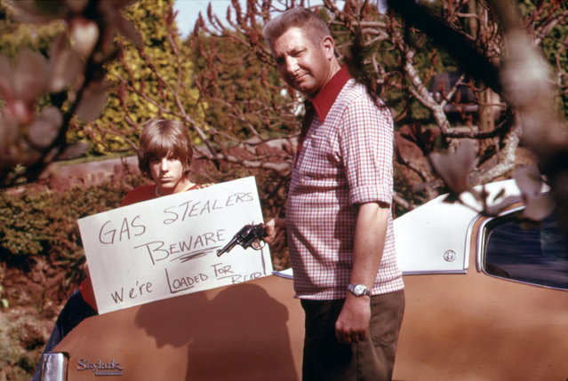 The country's fuel shortage led to problems for motorists in finding gas as well as paying much more for it, and resulted in theft from cars left unprotected. This Portland father and son made a sign warning thieves of the possible consequences, April 1974. (Photo by David Falconer/NARA via The Atlantic)