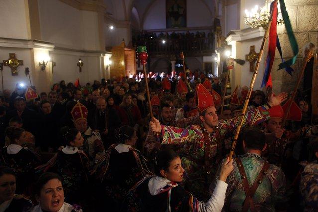"Believers dressed as ""diablos"" (devils) and ""danzantas"" (female dancers) dance in honour of San Blas (Saint Blaise) at the village's church during the ""Endiablada"" festival in Almonacid del Marquesado, in central Spain February 3, 2015. (Photo by Susana Vera/Reuters)"