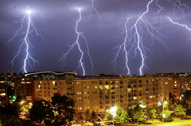 Lightning strikes over buildings during a thunderstorm in Belgrade, June 2011. (Photo by Marko Djurica/Reuters)