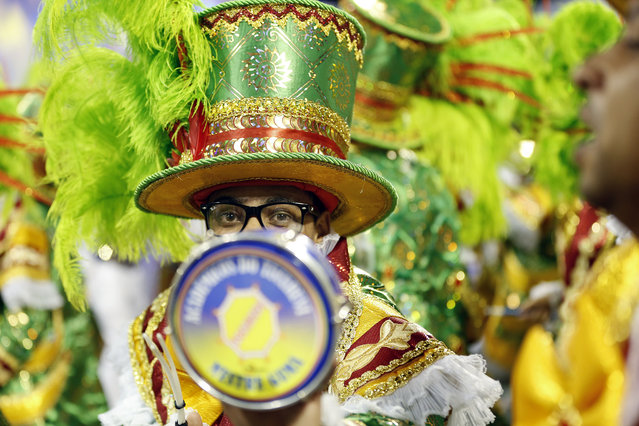 Drummers from the Academicos do Tucuruvi samba school perform during the Carnival parade at the Sambodromo in Sao Paulo, Brazil, Friday, February 13, 2015. (Photo by Andre Penner/AP Photo)