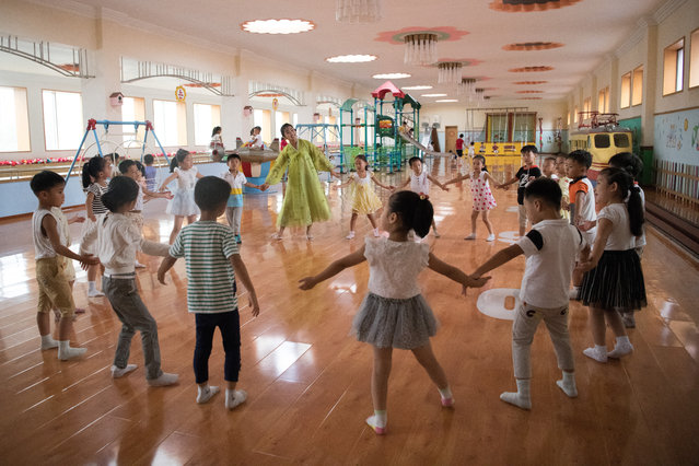 A teacher leads children in a play session at Gyongsang Kindergarten on August 23, 2018 in Pyongyang, North Korea. (Photo by Carl Court/Getty Images)