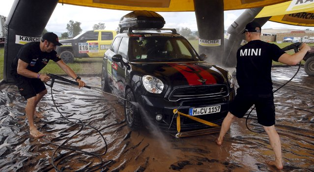 Mini drivers Nani Roma (L) of Spain and Mikko Hirvonen of Finland take part in a car washing competition of the Dakar Rally 2016 in Salta, Argentina, January 10, 2016. (Photo by Marcos Brindicci/Reuters)