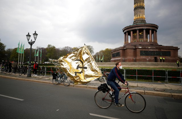 A protester attends a left wing bicycle May Day demonstration as the spread of the coronavirus disease (COVID-19) continues in Berlin, Germany, May 1, 2021. (Photo by Axel Schmidt/Reuters)