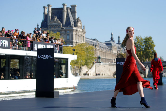 A model presents a creation on a giant catwalk installed on a barge on the Seine River during a public event organized by French cosmetics group L'Oreal as part of Paris Fashion Week, France, September 30, 2018. (Photo by Stephane Mahe/Reuters)