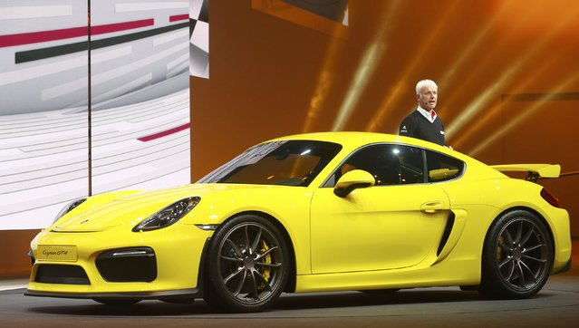 Matthias Mueller, CEO of Porsche, speaks next to a Porsche Cayman GT4 during a Volkswagen Group event ahead of the 85th International Motor Show in Geneva, March 2, 2015.            REUTERS/Arnd Wiegmann (SWITZERLAND  - Tags: TRANSPORT BUSINESS)