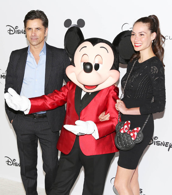 John Stamos and Caitlin McHugh attend Mickey's 90th Spectacular at The Shrine Auditorium in New York on October 6, 2018. (Photo by Milla Cochran/StartraksPhoto.com)