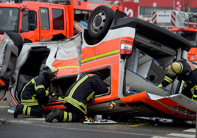 A toppeled ambulance vehicle that has been wrecked in an accident when it collided with another car during an emergency operation, in Kiel, Germany, 25 January 2016. Imediate information on the cause of the accident and the severity of the injuries were unavailable. (Photo by Carsten Rehder/EPA)