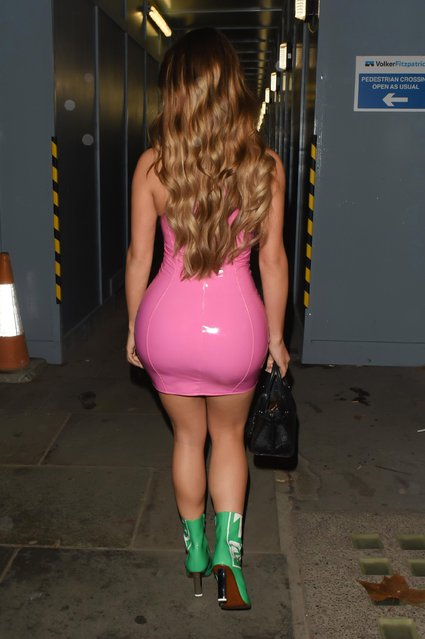 Model Demi Rose, 23, showed off her incredible figure in the skintight dress as she enjoyed a night out in London. England on November 17, 2018. (Photo by KP Pictures)