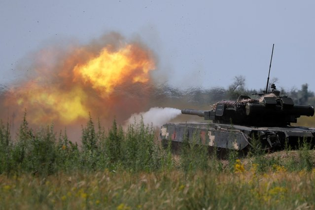 A tank of a Ukrainian marines fires during a military exercises near Kherson, as Ukraine and the United States stage land military exercises involving more than 30 countries as part of multinational Sea Breeze 2021 drills, in southern Ukraine, July 2, 2021. (Photo by Gleb Garanich/Reuters)