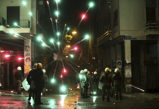 Protesters use fireworks against riot police during clashes in the Athens neighborhood of Exarchia, a haven for extreme leftists and anarchists, Thursday, December 6, 2018. New protest marches were underway in Greece Thursday evening on the 10th anniversary of the fatal police shooting of a teenager, hours after violent initial demonstrations where masked youths attacked police with firebombs and stones. (Photo by Yorgos Karahalis/AP Photo)