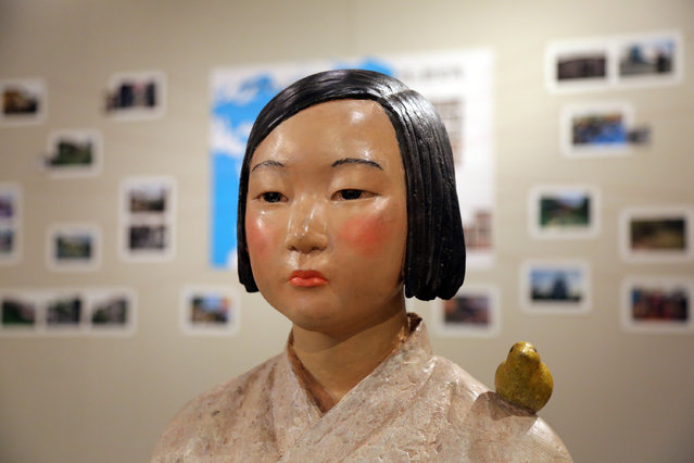 """A statue of a girl representing """"comfort women"""", or the victims of Japan's wartime sexual slavery, is displayed during an art exhibition at the Citizen's Gallery Sakae in Nagoya, central Japan, 06 July 2021. The exhibition titled 'After 'Freedom of Expression?,' which sparked controversy for featuring the statue roughly two years ago, opened on 06 July. (Photo by Yohnap/EPA/EFE)"""