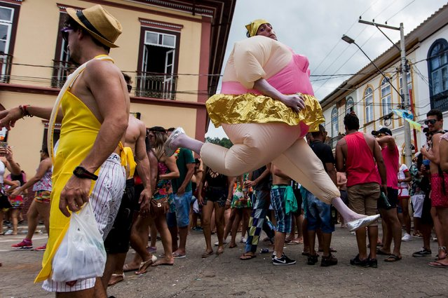Revellers participate during an annual block party in Sao Luiz do Paraitinga, Brazil, February 7, 2016. (Photo by Roosevelt Cassio/Reuters)
