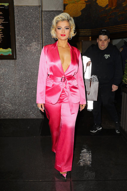Bebe Rexha wears satin fuchsia suit while leaving The Tonight Show Starring Jimmy Fallon in New York City on December 20, 2018. (Photo by Felipe Ramales/Splash News and Pictures)