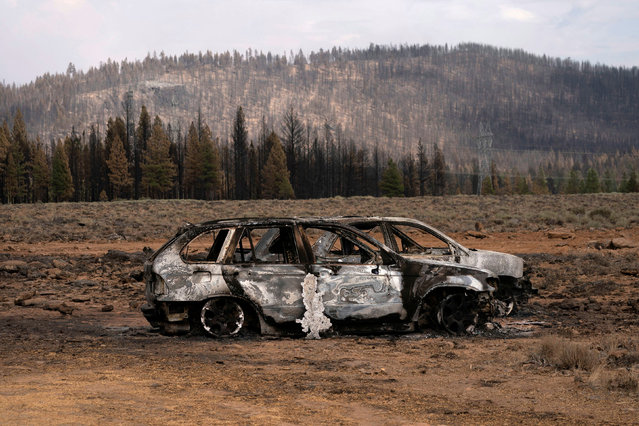 The remnants of cars destroyed by the Bootleg Fire are seen in a small community near Beatty, Oregon, U.S., July 19, 2021. (Photo by David Ryder/Reuters)