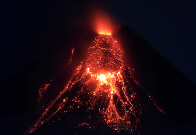 Lava flows from the crater of Mount Mayon Volcano during an eruption in Legazpi city, Albay province, south of Manila, Philippines, January 28, 2018. (Photo by Romeo Ranoco/Reuters)