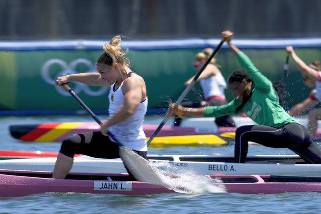 Lisa Jahn, of Germany, left, competes in the women's canoe single 200m quarterfinal at the 2020 Summer Olympics, Wednesday, August 4, 2021, in Tokyo, Japan. (Photo by Darron Cummings/AP Photo)