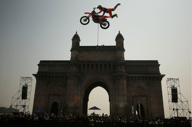 Alexey Kolesnikov of Russia performs during the freestyle motocross games Red Bull FMX Jam at the Gateway of India monument in Mumbai, India, February 2, 2019. (Photo by Francis Mascarenhas/Reuters)